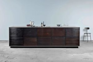 An Ikea Metod kitchen in bronzed tombac and sawn smoked oak veneer by the Danish company Reform