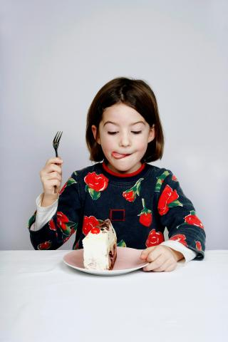 a girl and a dessert