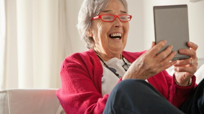 an old woman with a tablet